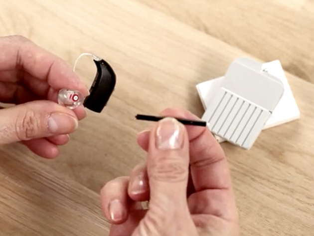 Cleaning a hearing aid